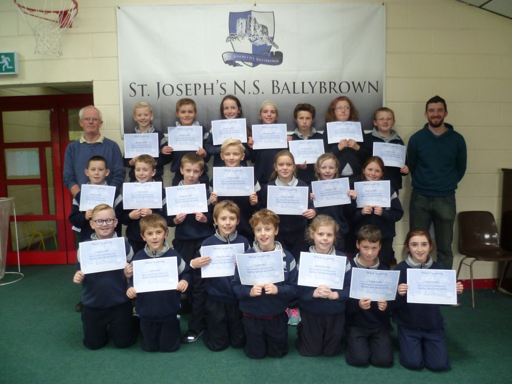 Third class in Ballybrown NS  proudly display their Cycling Safety certificates