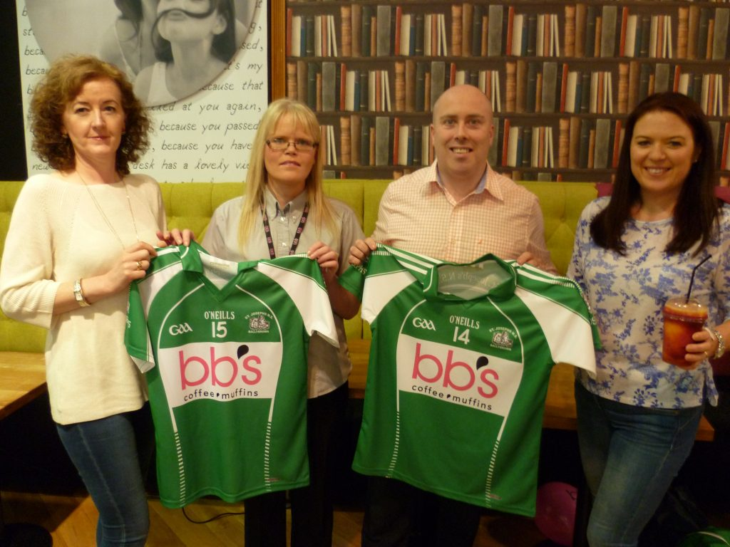 Sheila  Hayes and Sarah Keyes of Ballybrown NS accept a set of camogie jerseys from Sinead Lynch and Cian Murphy of BB's Muffins, Crescent Shopping Centre